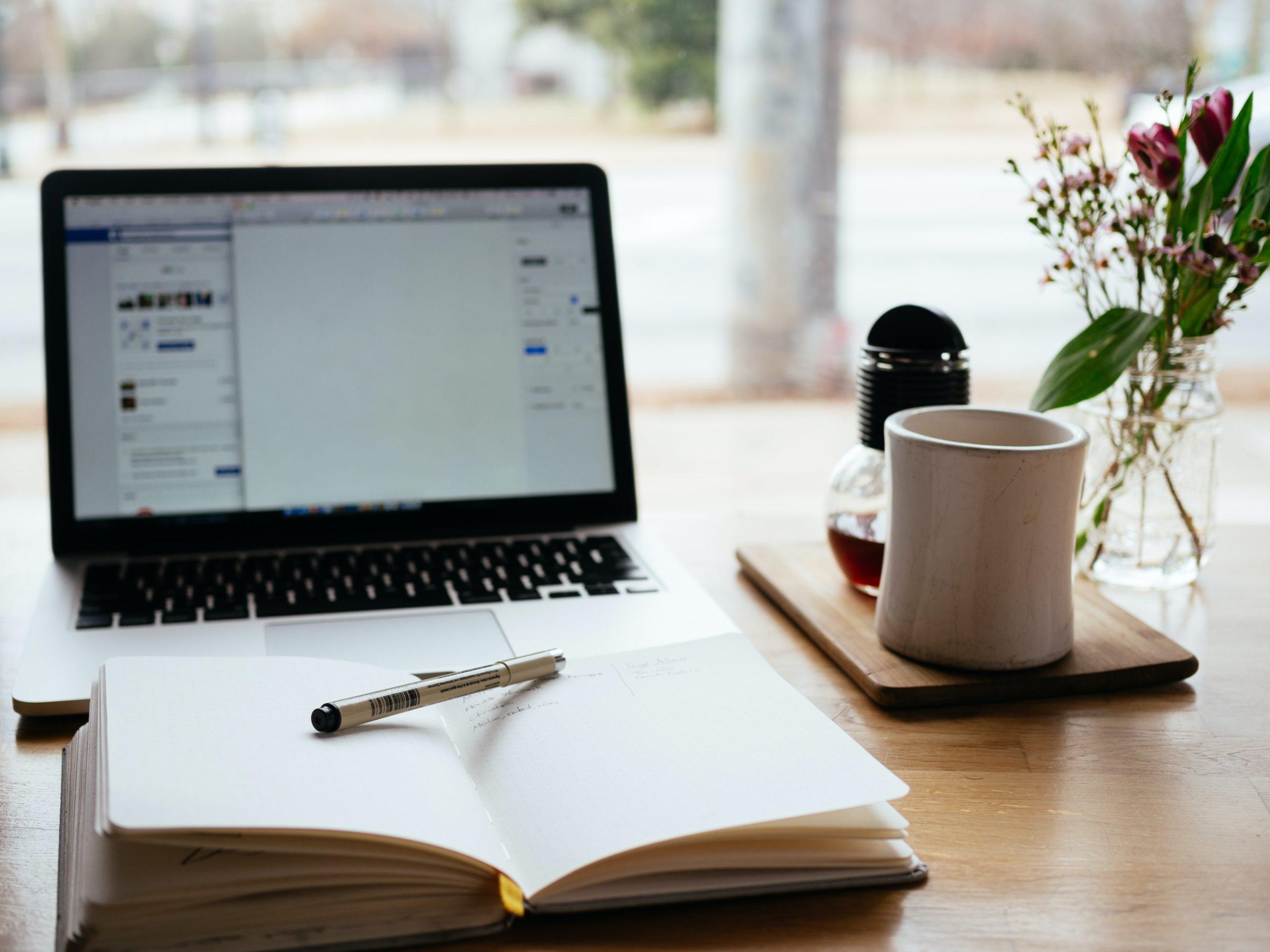 laptop, notebook and coffee mug